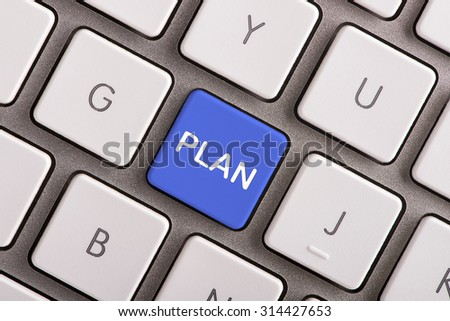 Plan button on white computer keyboard