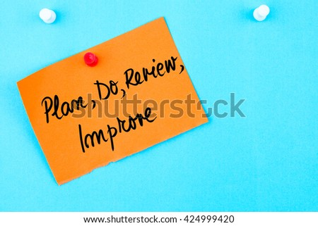 Plan, Do, Review, Improve written on orange paper note pinned on cork board with white thumbtack, copy space available - stock photo