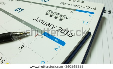 Plan for New Year 2016, Calendar of 2016 with Pen and Notebook on Office Desk - stock photo