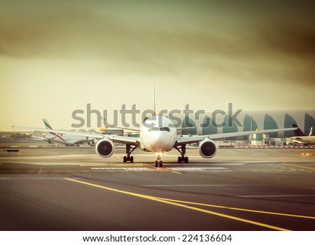 plane against the background of the airport  in the setting sun - stock photo