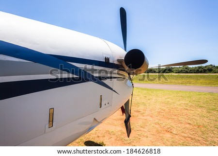 Plane Aircraft Tail Wing Blue Back of engine prop aircraft  blue sky - stock photo