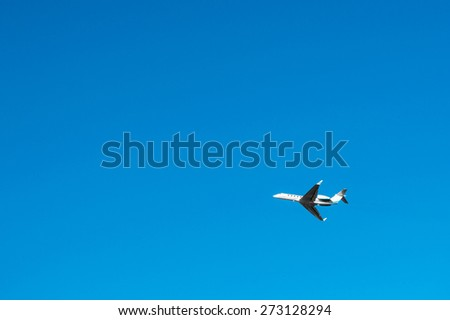Plane and blue sky - stock photo