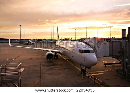 Plane at Melbourne Airport Terminal at Sunrise