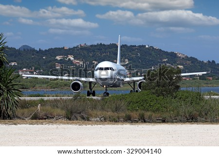 plane at the airport Corfu island Greece - stock photo