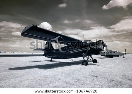 Plane at the airport. The infrared image. - stock photo