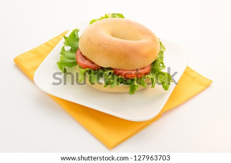 Plane bagel with lettuce and tomato
