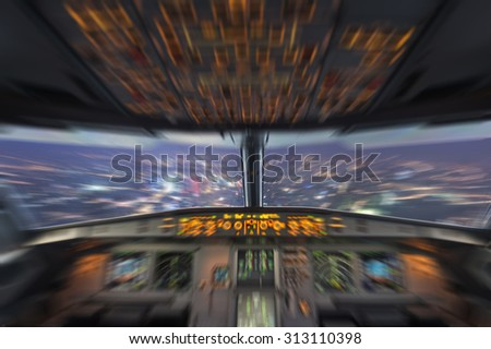 plane cockpit and city of night - stock photo