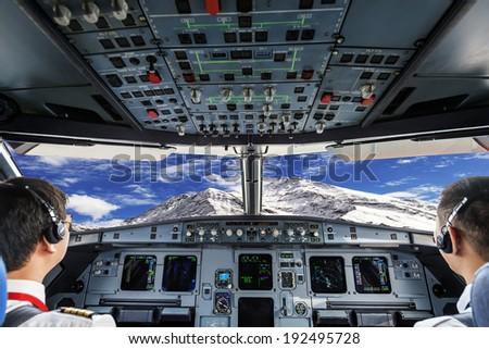 plane cockpit and snow mountain - stock photo