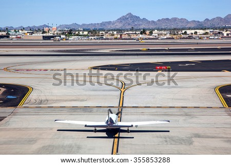 Plane entering taxiway preparing for take off - stock photo
