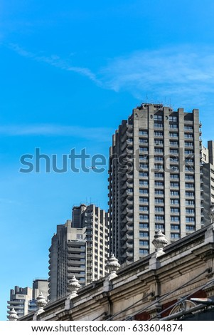Plane flies passed the Barbican Towers in the City of London