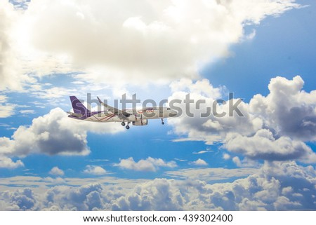 Plane flying above clouds with blue sky in background