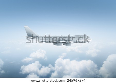 Plane flying above the clouds - stock photo