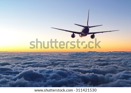 plane flying away in the sky - stock photo