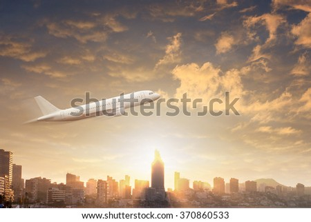 Plane flying in the sky through dramatic storm clouds against silhouettes of the modern city