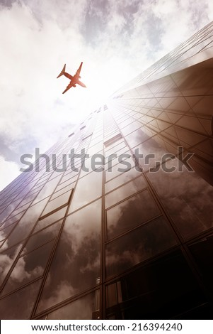 plane flying over an office building in Frankfurt am Main, Germany - stock photo