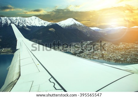 plane flying over queenstown impotant traveling destination in south island new zealand