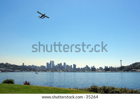 Plane flying over Seattle, WA - stock photo