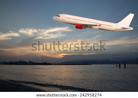 Plane flying over the beach during your vacation - stock photo