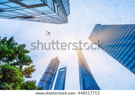 plane flying over the skyscrapers
