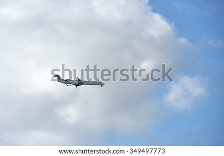Plane going in the sky, plane arrival, plane landing, aircraft in the blue sky background, departure, travel concept
