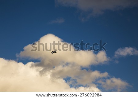 plane in blue sky - stock photo
