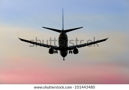 Plane in the air at sunset ( sunrise ) time. Vancouver. Canada. - stock photo
