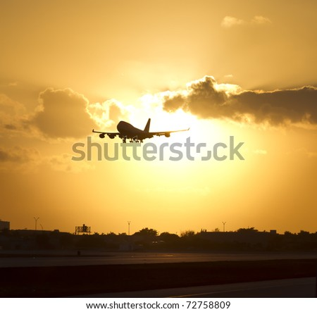 plane in the sky, arriving from a long trip to touch down at the landing pad. - stock photo