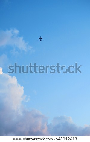 Plane in the sky with clouds