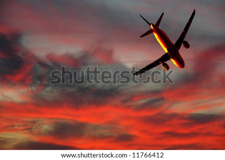 Plane is flying while the sun is setting