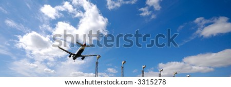 Plane is going to land in an airport 1:3 - stock photo