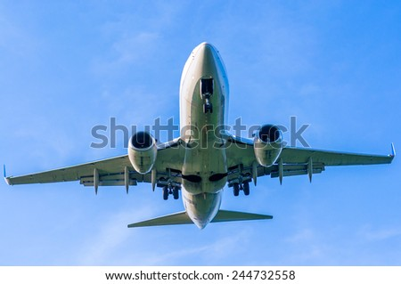 Plane just a minutes from landing - stock photo