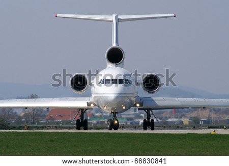 Plane lining up the runway - stock photo