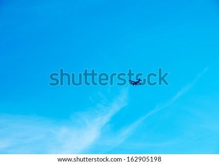 plane on blue sky - stock photo