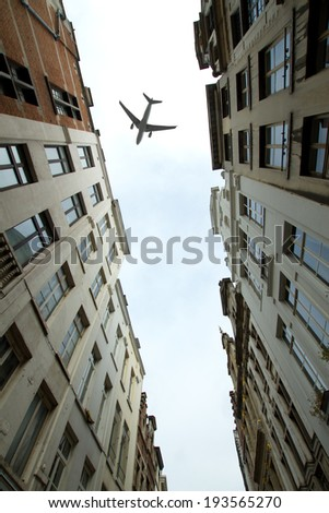 plane over the city of Brussels tilt - shift  - stock photo