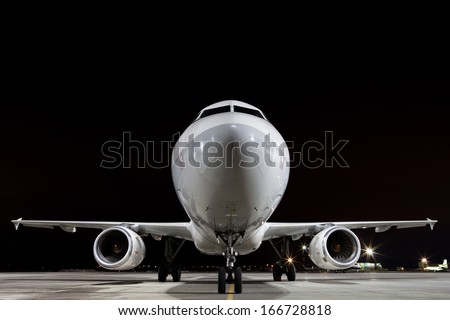 plane parked at airport - stock photo
