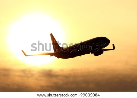 plane silhouette in sunset - stock photo