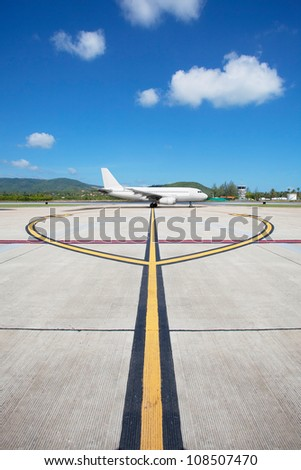 Plane taking off and taxiing right on the line - stock photo