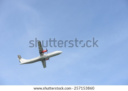 Plane taking off in the blue sky - stock photo