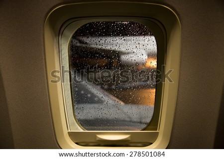 Plane Window - stock photo