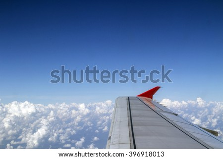 Plane wing on the sky
