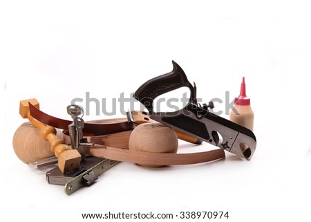 Planer, lathe wood products, key lock, glue on a white background - stock photo