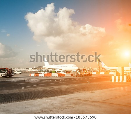 planes and the airport in the setting sun - stock photo