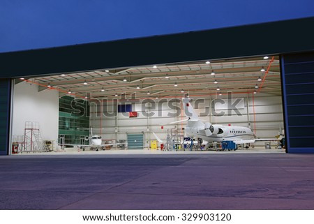 planes in the hangar - stock photo