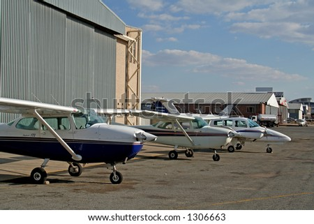 Planes outside hanger
