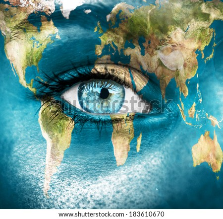 "Planet earth and blue human eye - ""Elements of this image furnished by NASA"" - stock photo"