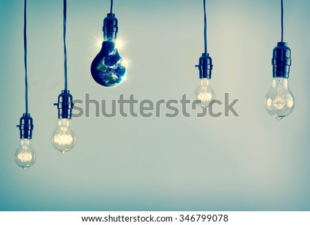 Planet earth and lightbulb for global power and energy concept, Elements of image from NASA - stock photo