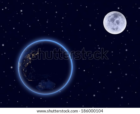 Planet earth and moon on night sky. Australia and part of Asia. Elements of this image furnished by NASA. - stock photo