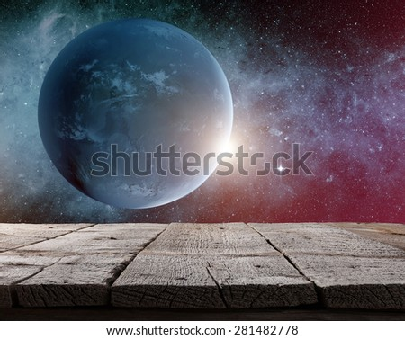 Planet earth from the space with wooden floor. Some elements of this image furnished by NASA - stock photo