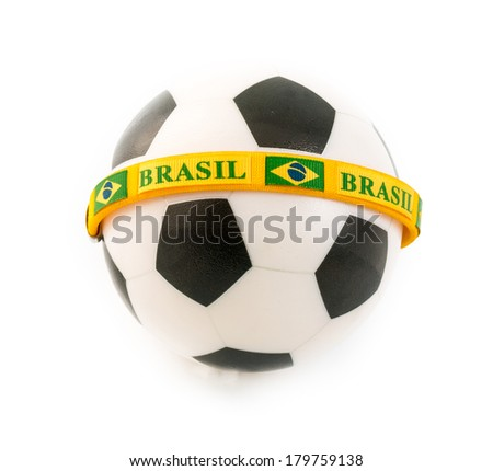 Planet earth gets ready for the soccer championship to be held in Brazil during 2014. Soccer ball with a Brazil bracelet wrapped around - stock photo