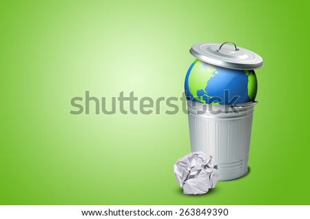 Planet earth in a trash can and crumpled paper - stock photo